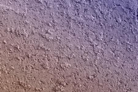 pretty aged purple stone like stucco texture for use as background. Reklamní fotografie