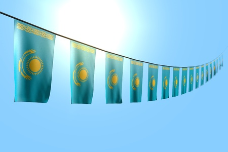 wonderful memorial day flag 3d illustration  - many Kazakhstan flags or banners hanging diagonal on string on blue sky background with selective focus
