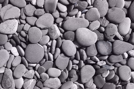 wonderful dry lake shore pebbles texture - abstract photo background