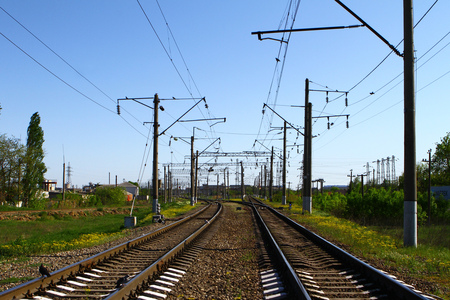 Rail way on country side in summer with a lot of electric poles on it sides 版權商用圖片