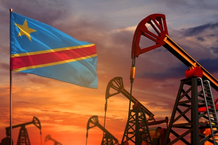 Democratic Republic of Congo oil industry concept, industrial illustration. Democratic Republic of Congo flag and oil wells and the red and blue sunset or sunrise sky background - 3D illustration Reklamní fotografie