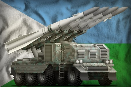 tactical short range ballistic missile with arctic camouflage on the Djibouti flag background. 3d Illustration