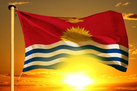 Kiribati flag weaving on the beautiful orange sunset background