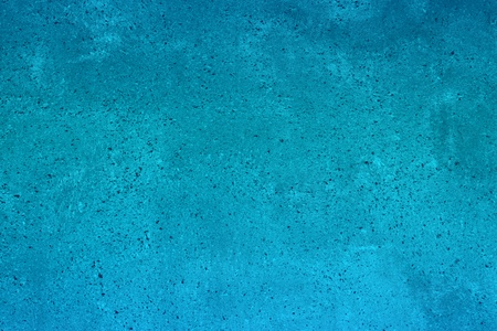 beautiful light blue grainy aged stucco on the table texture - abstract photo background