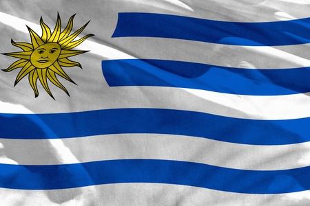 Fluttering Uruguay flag for using as texture or background, the flag is waving on the wind Banco de Imagens