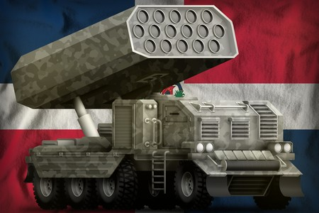 rocket artillery, missile launcher with grey camouflage on the Dominican Republic flag background. 3d Illustration Фото со стока