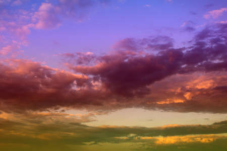 amazing toned sun colored partially cloudy sky for using as background in design. 版權商用圖片