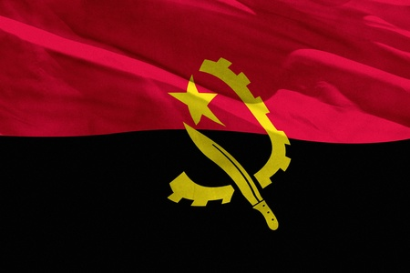 Fluttering Angola flag for using as texture or background, the flag is waving on the wind Foto de archivo