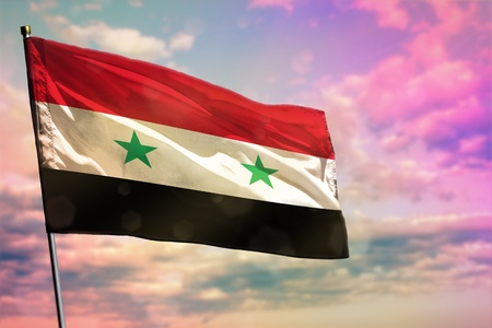 Fluttering Syrian Arab Republic flag on colorful cloudy sky background. Syrian Arab Republic prospering concept.