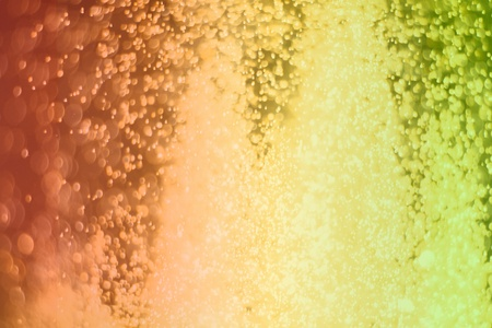 nice orange a lot of flying multi colored glitter bokeh texture - abstract photo background