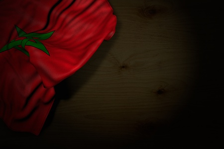 pretty anthem day flag 3d illustration  - dark photo of Morocco flag with big folds on dark wood with free place for content