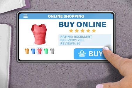 online shopping technology concept - hand with mobile phone tapping the button buy on stone table background Reklamní fotografie - 124803961
