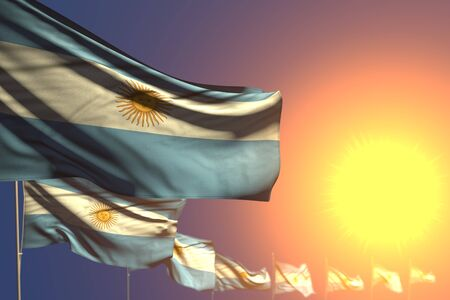 nice many Argentina flags on sunset placed diagonal with soft focus and place for your content - any celebration flag 3d illustration