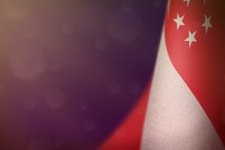 Singapore hanging flag for honour of veterans day or memorial day on purple dark velvet background. Singapore glory to the heroes of war concept.