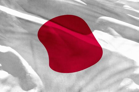 Fluttering Japan flag for using as texture or background, the flag is waving on the wind Stock Photo