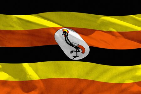 Fluttering Uganda flag for using as texture or background, the flag is waving on the wind Foto de archivo