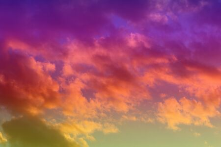amazing vivid sun colored clouds on the sky for using as background in design. 免版税图像