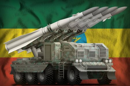 tactical short range ballistic missile with arctic camouflage on the Ethiopia flag background. 3d Illustration