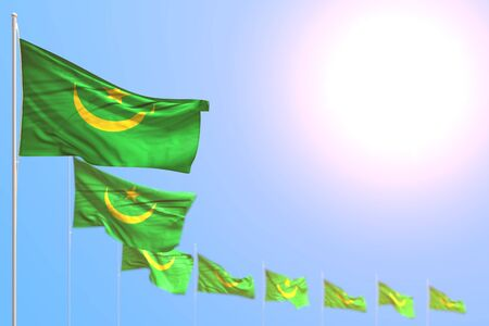 wonderful many Mauritania flags placed diagonal with bokeh and empty space for text - any holiday flag 3d illustration