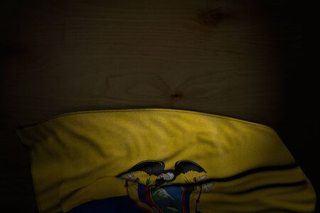 nice dark image of Ecuador flag with large folds on dark wood with empty space for your text - any feast flag 3d illustration Stok Fotoğraf
