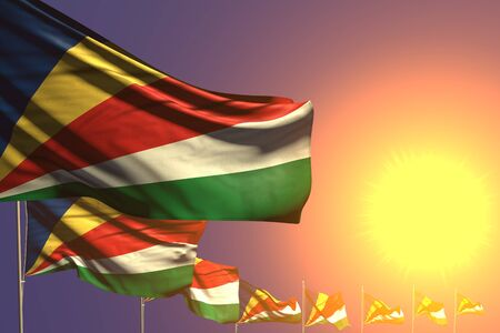 beautiful many Seychelles flags placed diagonal on sunset with space for text - any celebration flag 3d illustration