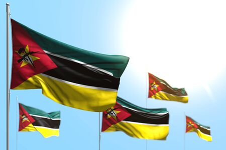 pretty feast flag 3d illustration  - 5 flags of Mozambique are waving against blue sky illustration with soft focus Banco de Imagens