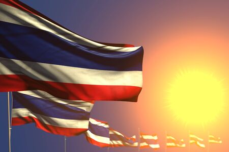 pretty many Thailand flags on sunset placed diagonal with bokeh and space for your text - any occasion flag 3d illustration