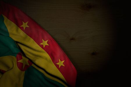 nice celebration flag 3d illustration  - dark photo of Grenada flag with large folds on dark wood with empty space for content