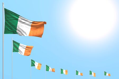 wonderful many Ireland flags placed diagonal on blue sky with place for content - any feast flag 3d illustration