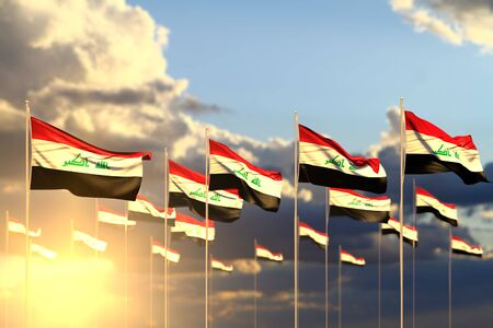 pretty many Iraq flags on sunset placed in row with selective focus and space for your content - any celebration flag 3d illustration Banco de Imagens