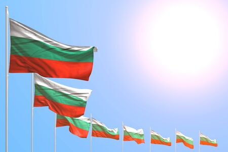 wonderful any feast flag 3d illustration  - many Bulgaria flags placed diagonal on blue sky with place for content Banco de Imagens