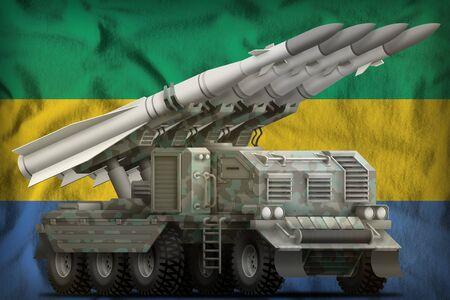 tactical short range ballistic missile with arctic camouflage on the Gabon flag background. 3d Illustration