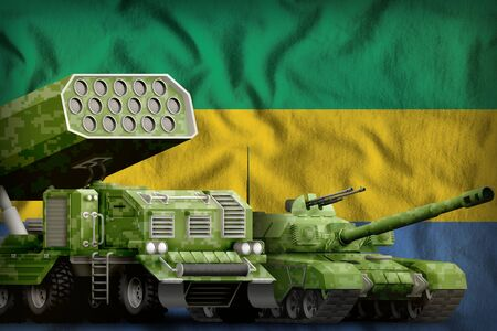 tank and rocket launcher with summer pixel camouflage on the Gabon flag background. Gabon heavy military armored vehicles concept. 3d Illustration 版權商用圖片