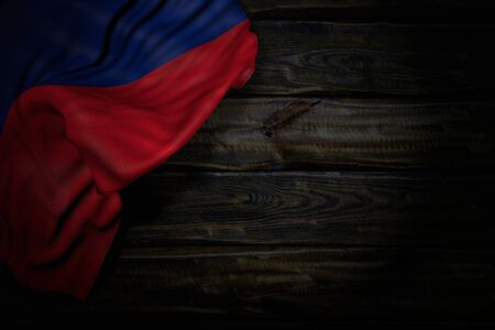 cute dark photo of Liechtenstein flag with big folds on old wood with empty place for content - any holiday flag 3d illustration Stockfoto