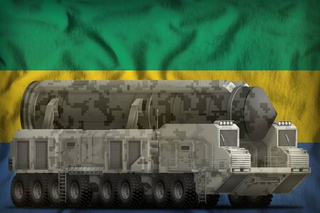 intercontinental ballistic missile with city camouflage on the Gabon flag background. 3d Illustration