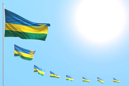 wonderful anthem day flag 3d illustration  - many Rwanda flags placed diagonal with bokeh and free space for your text