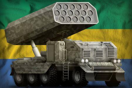 rocket artillery, missile launcher with grey camouflage on the Gabon flag background. 3d Illustration 版權商用圖片