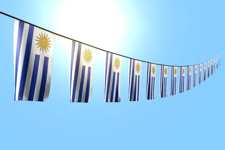 pretty many Uruguay flags or banners hangs diagonal on rope on blue sky background with selective focus - any feast flag 3d illustration Imagens