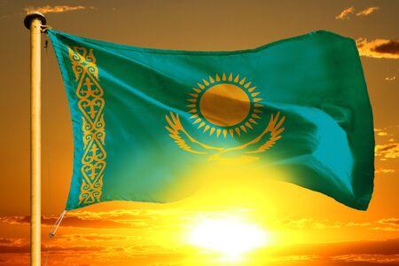 Kazakhstan flag weaving on the beautiful orange sunset background Stock fotó
