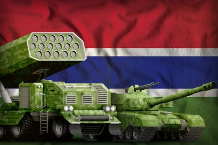 tank and rocket launcher with summer pixel camouflage on the Gambia flag background. Gambia heavy military armored vehicles concept. 3d Illustration Imagens