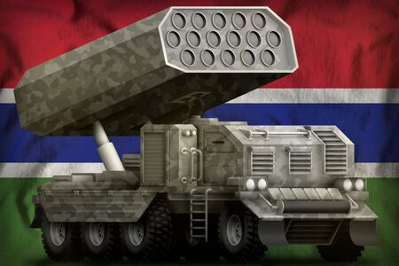 rocket artillery, missile launcher with grey camouflage on the Gambia flag background. 3d Illustration