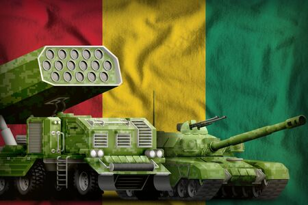tank and rocket launcher with summer pixel camouflage on the Guinea flag background. Guinea heavy military armored vehicles concept. 3d Illustration Imagens