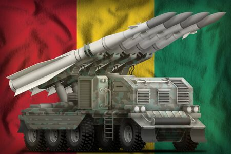 tactical short range ballistic missile with arctic camouflage on the Guinea flag background. 3d Illustration