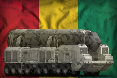 intercontinental ballistic missile with city camouflage on the Guinea flag background. 3d Illustration Imagens