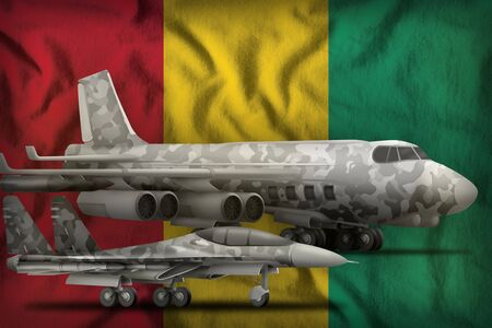 air forces with grey camouflage on the Guinea flag background. Guinea air forces concept. 3d Illustration Imagens