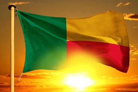 Benin flag weaving on the beautiful orange sunset background