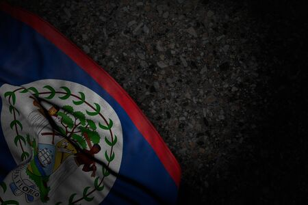 wonderful dark photo of Belize flag with big folds on dark asphalt with empty space for content - any holiday flag 3d illustration 版權商用圖片