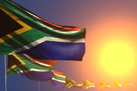 beautiful many South Africa flags on sunset placed diagonal with soft focus and space for your content - any occasion flag 3d illustration