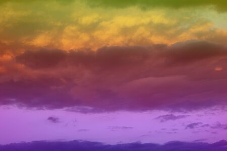 lovely unreal colorful fantasy sun colored clouds on the sky for using as background in design.