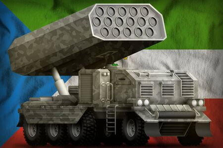rocket artillery, missile launcher with grey camouflage on the Equatorial Guinea flag background. 3d Illustration